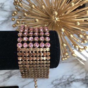 Gold bracelet with pink rhinestones